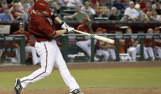 Arizona Diamondbacks' Aaron Hill connects for a home run off Washington Nationals' Doug Fister during the fourth inning of a baseball game Wednesday, May 14, 2014, in Phoenix. (AP Photo)