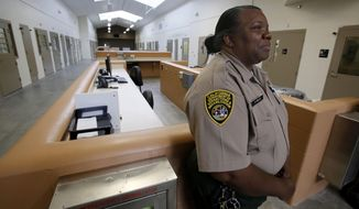 FILE -- In this June 25, 2013 file photo, Correctional Officer Stella Miles stands in one of the secure inmate-patient housing units of the new California Correctional Health Care Facility in Stockton, Calif.  Gov. Jerry Brown is seeking millions of dollars in his revised 2014-15 state budget plan to correct problems in the recently constructed $839 million facility  the can treat up to 1,720 inmate-patients. (AP Photo/Rich Pedroncelli)