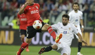 Benfica's Lima fights for the ball against Sevilla's Coke during the Europa League soccer final between Sevilla and Benfica, at the Turin Juventus stadium in Turin, Italy, Wednesday, May 14, 2014. (AP Photo/Andrew Medichini)