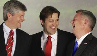 Republican Senate hopeful Ben Sasse, center, laughs with Rep. Jeff Fortenberry, R-Neb., left, and Neb. Gov. Dave Heineman in Lincoln, Neb., Tuesday, May 13, 2014, after winning his party's primary election. A crowd of Republican candidates jockeyed to succeed Nebraska's outgoing governor and senior U.S. senator in a busy primary election where voters also were set to select nominees for three other vacant offices. (AP Photo)