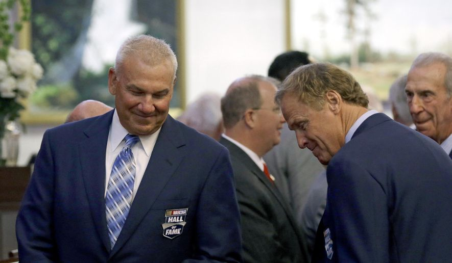 NASCAR racing legends Dale Jarrett, left, and Rusty Wallace are seated on the House floor during the opening session of the General Assembly in Raleigh, N.C., Wednesday, May 14, 2014 where lawmakers honored the NASCAR Hall of Fame inductees. (AP Photo)  **FILE**