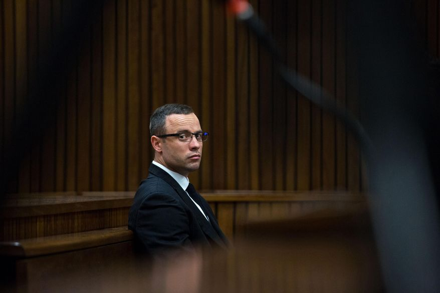 Oscar Pistorius,  listens to psychiatric evidence for his defense during his ongoing murder trial in Pretoria, South Africa, Tuesday, May 13, 2014. Pistorius is charged with the shooting death of his girlfriend Reeva Steenkamp on Valentine's Day in 2013. (AP Photo/Daniel Born, Pool)
