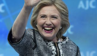 Former Secretary of State Hillary Rodham Clinton waves to the audience at the conclusion of her address to the American Jewish Committee (AJC) Global Forum closing plenary in Washington, Wednesday, May 14, 2014. (AP Photo/Cliff Owen)