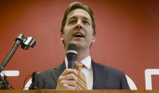 Republican Senate candidate Ben Sasse speaks at a Republican unity rally in Lincoln, Neb., Wednesday, May 14, 2014. With Sasse, tea party groups figured out the riddle of electing one of their own in 2014: Claim a Republican as a member of the tribe, even if he insists on talking about solutions and not just grievances.  (AP Photo)