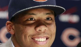 Chicago Bears first round draft pick Kyle Fuller, a cornerback from Virginia Tech, smiles as he responds to a question after being introduced at an NFL football news conference Friday, May 9, 2014, in Lake Forest, Ill. (AP Photo/Charles Rex Arbogast)