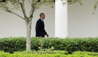 President Barack Obama walks past the Rose Garden as he heads to Marine One on the South Lawn of the White House in Washington, Wednesday, May 14, 2014. The Obama's are heading to New York. (AP Photo)