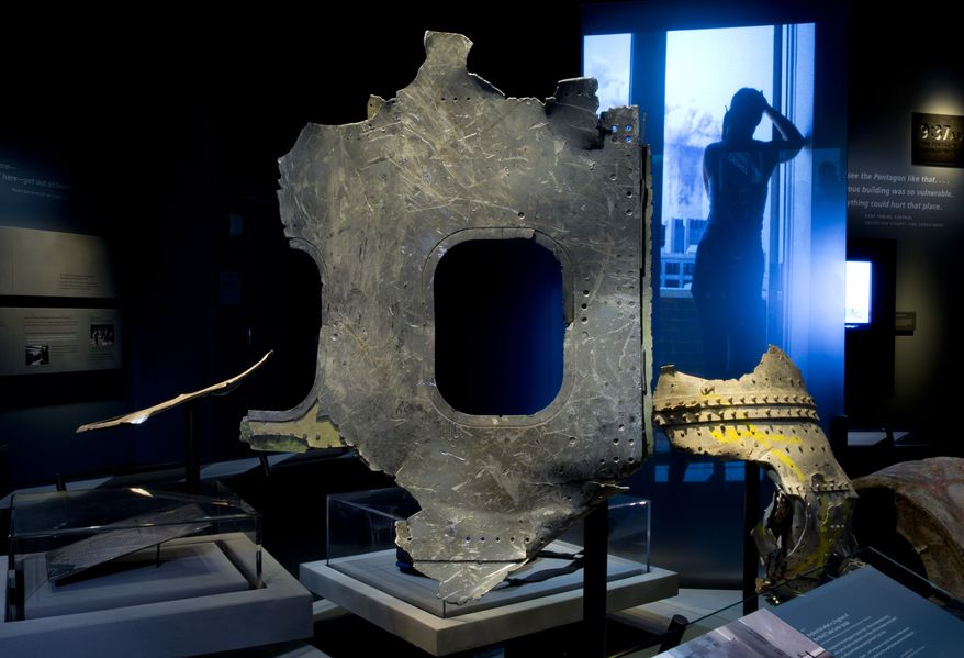 In this May 5, 2014 photo released by the National September 11 Memorial Museum, a piece of airplane damaged in the attacks of September 11, 2001, is displayed at the New York museum. The long-delayed museum will be dedicated during a ceremony Thursday, May 15, 2014. (AP Photo/National September 11 Memorial Museum, Jin Lee)