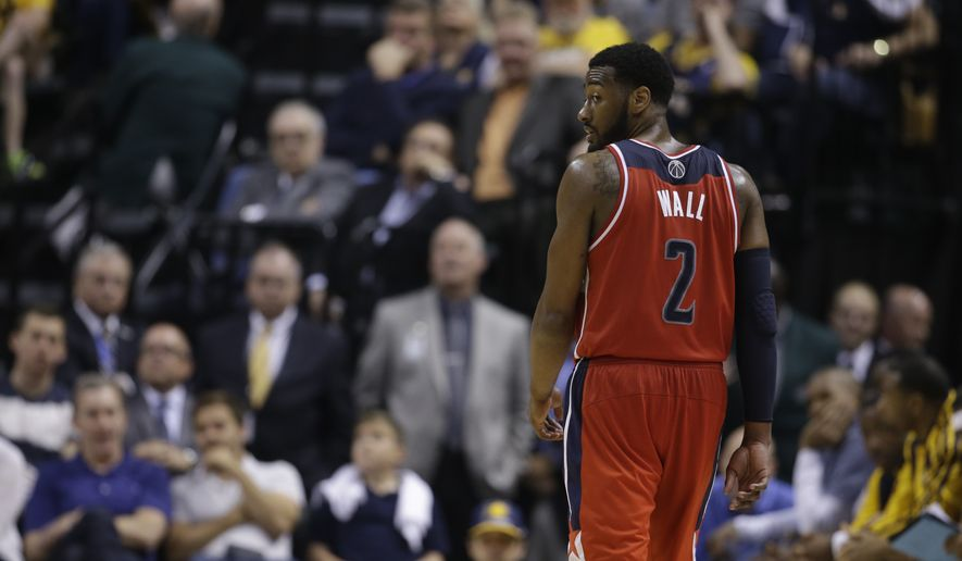 Washington Wizards' John Wall (2) in action during the second half of game 5 of the Eastern Conference semifinal NBA basketball playoff series against the Indiana Pacers Tuesday, May 13, 2014, in Indianapolis. Washington defeated Indiana 102-79. (AP Photo/Darron Cummings)