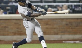 New York Yankees' Alfonso Soriano swings on a seventh-inning run-scoring double in a baseball game against the New York Mets in New York, Thursday, May 15, 2014. (AP Photo/Kathy Willens)
