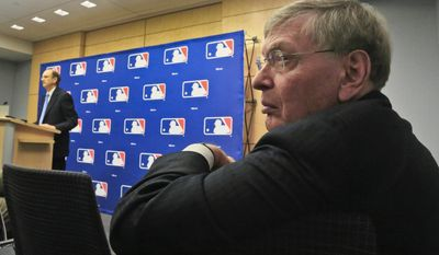 Major League Baseball Commissioner Bud Selig, right, listens as St. Louis Cardinals chairman Bill DeWitt, left, fields questions during a press conference, Thursday, May 15, 2014 at MLB headquarters in New York.  DeWitt was appointed chairman of a succession committee to determine the process for replacing Selig, who has headed baseball since 1992 and plans to retire in January 2015.  (AP Photo/Bebeto Matthews)