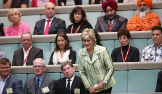 New Zealand's Dame Kiri Te Kanawa, bottom center, bows as she is acknowledged while attending question time in the House of Representatives at the Australian Parliament in Canberra, Thursday, May 15, 2014. Dame Kiri is on her 70th Birthday Gala Tour. (AP Photo/Rick Rycroft)