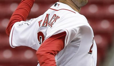 Cincinnati Reds starting pitcher Jeff Francis throws to the San Diego Padres in the first inning of a baseball game, the second of a doubleheader, Thursday, May 15, 2014, in Cincinnati. (AP Photo/Al Behrman)