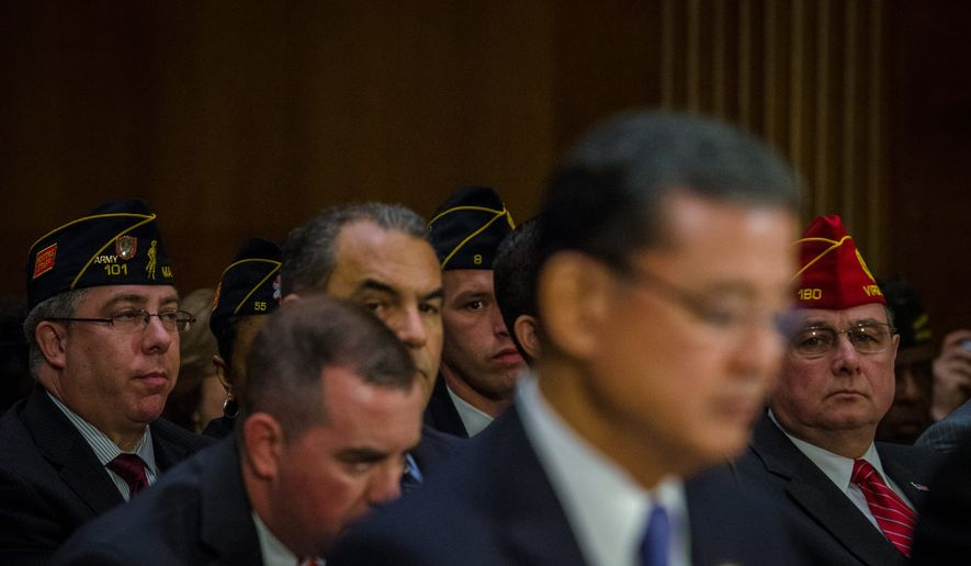 "WANTING ANSWERS: Veterans attend a Senate committee hearing this week investigating reports of long wait times at Veterans Affairs health care facilities across the country. Veterans Affairs Secretary Eric K. Shinseki (foreground) said he is ""mad as hell"" and won't leave his post until he completes his mission or is fired by President Obama. (Rod Lamkey Jr./Special to the Washington Times)"