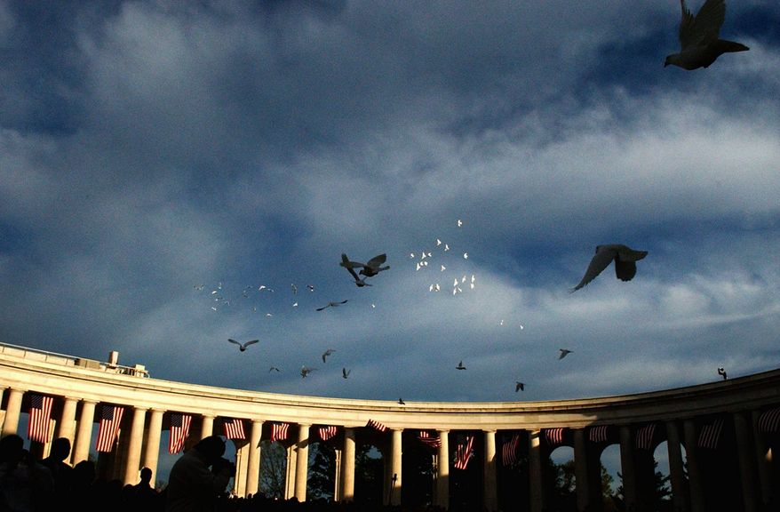 Doves were released at Arlington Cemetery for the Easter Sunrise Service at the Arlington National Cemetery Ampitheater, on Easter Sunday in 2006. (The Washington Times)