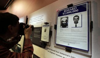 The wanted posters of Osama Bin Laden, left, and Khaled Shaikh Mohammad are displayed at the National Sept. 11 Memorial Museum, Wednesday, May 14, 2014, in New York. (AP Photo) ** FILE **