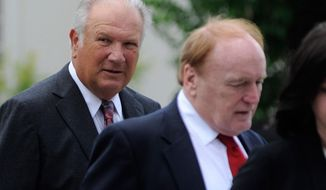 Former University of Georgia football coach Jim Donnan, left, heads into the Federal Courthouse on Wednesday, May 14, 2014, Athens, Ga.  Prosecutors say the 69-year-old and another man ran a fraudulent investment scheme from September 2007 to December 2010 through GLC Limited, a West Virginia-based company dealing in wholesale and closeout merchandise. Prosecutors say the pair promised high rates of return but paid investors with other investor money. (AP Photo/Athens Banner-Herald, Richard Hamm) MAGS OUT; MANDATORY CREDIT