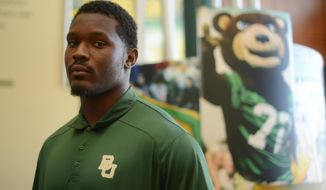 FOR RELEASE SUNDAY, MAY 18, 2014, AT 12:01 A.M. CDT.- This photo taken April 30, 2014, shows defensive lineman Javonte Magee, who graduated from Sam Houston High School, and has returned to Baylor University after taking a semester off. (AP Photo/The San Antonio Express-News, Billy Calzada)