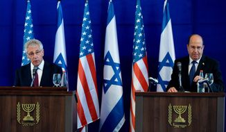 U.S. Defense Secretary Chuck Hagel, left, and Israel's Defense Minister Moshe Yaalon, right, speak during a joint conference following a meeting at Israel's Defense Force headquarters in Tel Aviv, Thursday, May 15, 2014. Hagel is on a regional tour focusing on Iran's nuclear program and Syria's civil war. (AP Photo/Mandel Ngan, Pool)