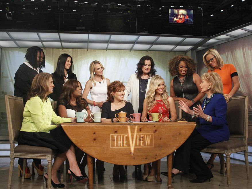 """This image released by ABC shows, standing from left, Whoopi Goldberg, Lisa Ling, Elisabeth Hasselbeck, Rosie O'Donnell Sherri Shepherd and Jenny McCarthy, and seated from left, Meredith Vieira, Star Jones, Joy Behar, Debbie Matenopoulos and Barbara Walters on the set of the daytime talk series """"The View,"""" Thursday, May 15, 2014 in New York. (AP Photo/ABC, Lou Rocco)"""