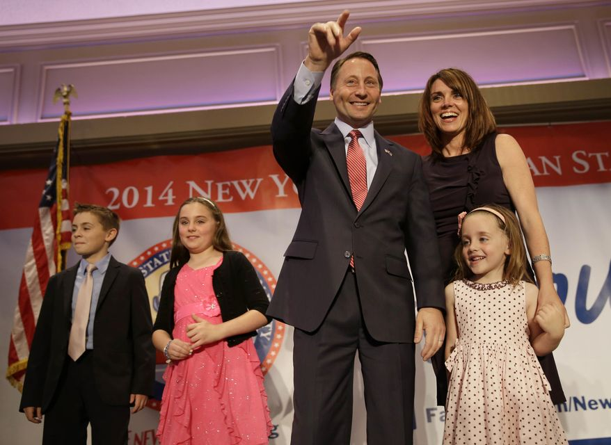 The Republican nominee for governor Rob Astorino, center, arrives on the stage with his wife, Sheila McCloskey, second from right, and their children Sean, left, Kiley, second from left, and Ashlin during the New York State Republican Convention in Rye Brook, N.Y., Thursday, May 15, 2014. Republicans wrapped up their state party convention Thursday in Westchester County after nominating Astorino and other candidates for statewide office.  (AP Photo/Seth Wenig)