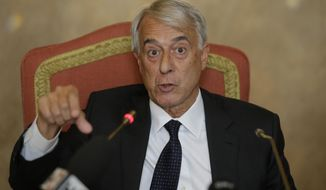 Milan's mayor and La Scala board chairman Giuliano Pisapia speaks during a news conference in Milan, Italy, Thursday, May 15, 2014. The board of La Scala voted Thursday to oust its incoming general director at the end of his first season in the latest behind-the-scenes melodrama to roil the fabled opera house. Salzburg Festival director Alexander Pereira had been given a five-season contract. But the board voted to oust him after the upcoming 2014-2015 season amid allegations of a conflict of interest. La Scala board chairman Giuliano Pisapia said Pereira overreached his powers by making a deal for La Scala to buy four operas from the Salzburg Festival, where he is still director, before officially assuming his role in La Scala on Oct. 1. (AP Photo/Luca Bruno)