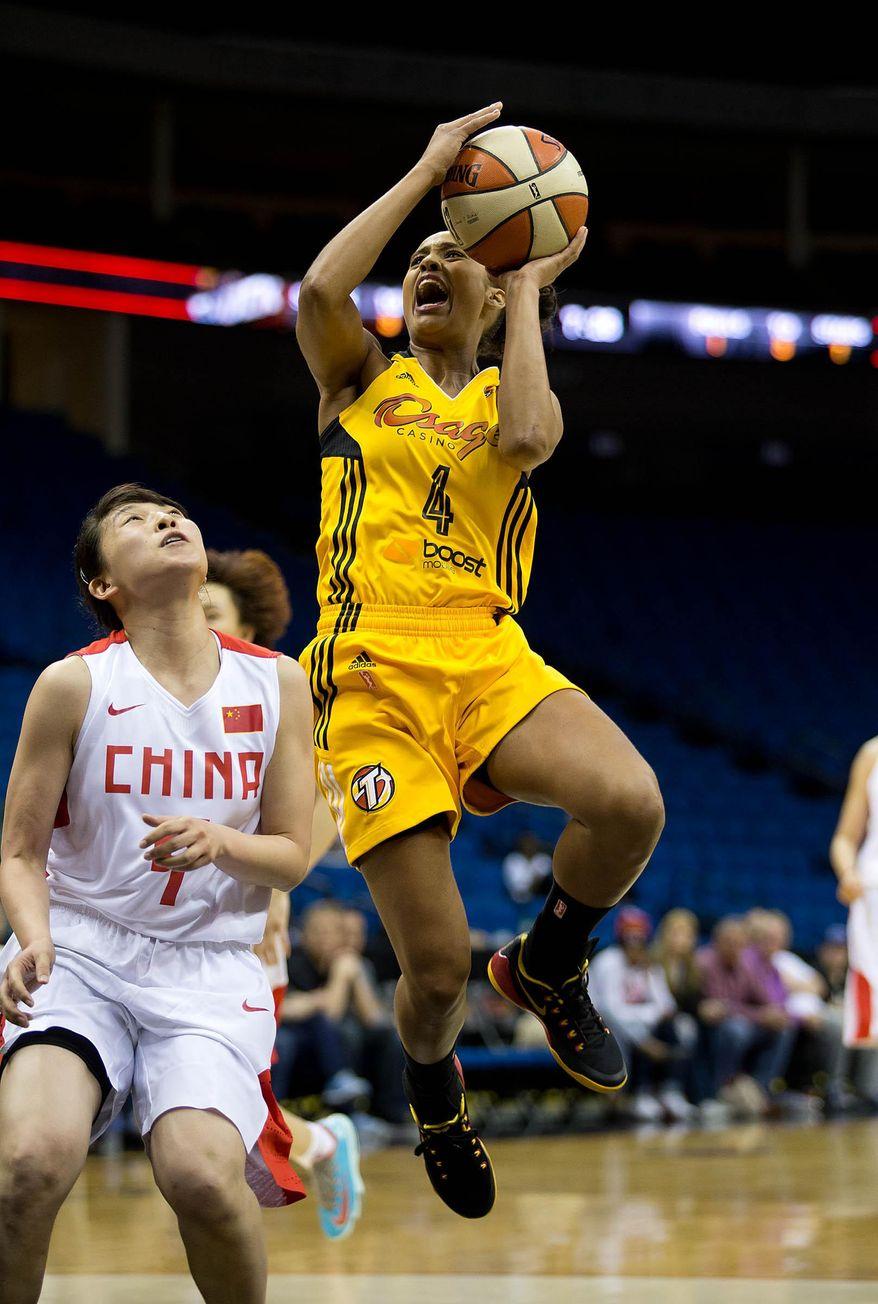 Shock's Skylar Diggins (4) shoots during a WNBA basektball game against Team China Monday, May 12, 2014, in Tulsa, Okla.  (AP Photo/Tulsa World,  Joey Johnson)