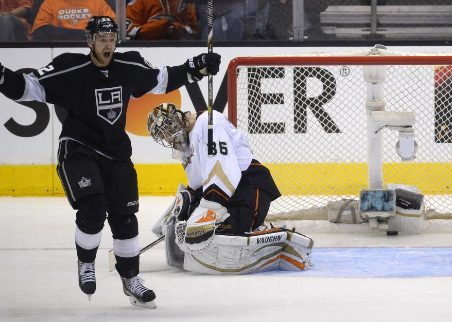 Los Angeles Kings center Trevor Lewis, left, celebrates his goal as Anaheim Ducks goalie John Gibson reacts during the second period in Game 6 of an NHL hockey second-round Stanley Cup playoff series, Wednesday, May 14, 2014, in Los Angeles. (AP Photo)