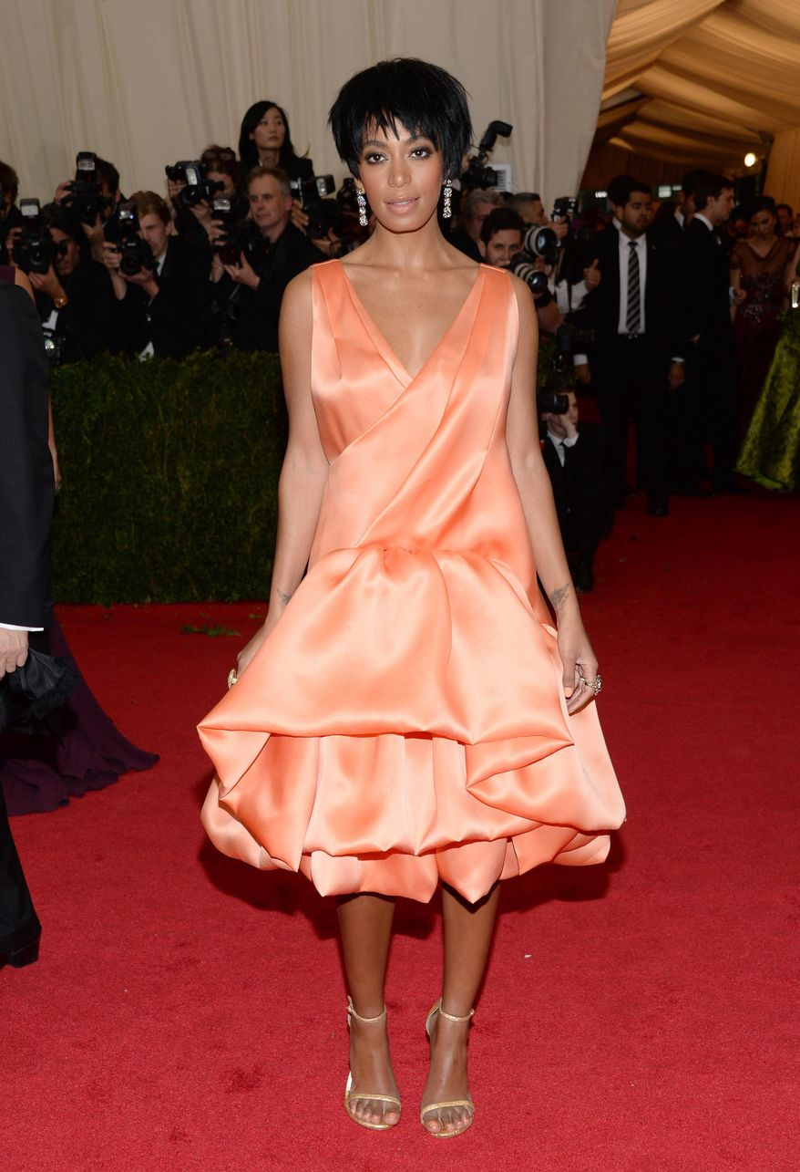 "FILE - This May 5, 2014 file photo shows Solange Knowles, sister of Beyonce Knowles, at The Metropolitan Museum of Art's Costume Institute benefit gala celebrating ""Charles James: Beyond Fashion"" in New York. Beyonce, Jay Z and Solange say they have worked through and are moving on since a video leaked this week of Solange attacking Jay Z in an elevator inside the Standard Hotel after the May 5, gala. (Photo by Evan Agostini/Invision/AP)"