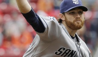 San Diego Padres starting pitcher Ian Kennedy throws against the Cincinnati Reds in the first inning of a baseball game, Thursday, May 15, 2014, in Cincinnati. (AP Photo/Al Behrman)
