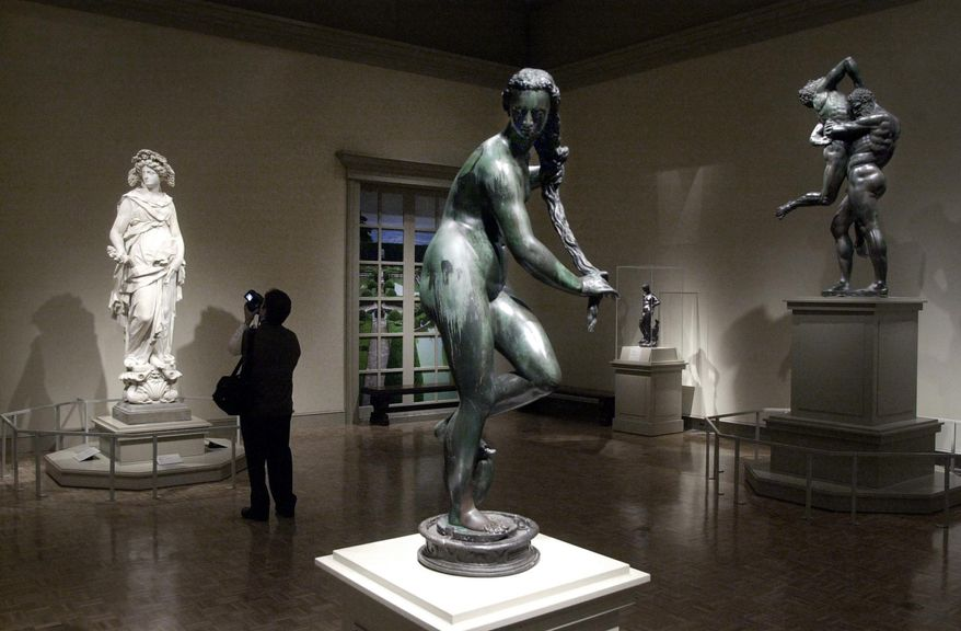 """FILE-- In this March 13, 2003 file photo, a woman views Italian sculptures at the """"Magnificenza! The Medici, Michelangelo and The Art of Late Renaissance Florence,"""" at the Detroit Institute of Arts in Detroit. Valuable art is back on the docket in Detroit's bankruptcy case. A judge is holding a hearing Thursday, May 15, 2014 on many issues, including a request by some creditors to force the city to work on ways to make money from art at the Detroit Institute of Arts. (AP Photo/Paul Sancya)"""