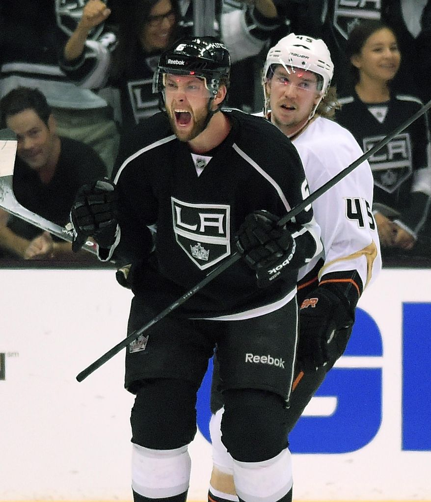 Los Angeles Kings defenseman Jake Muzzin, left, celebrates his goal as Anaheim Ducks left wing Patrick Maroon looks on during the first period in Game 6 of an NHL hockey second-round Stanley Cup playoff series, Wednesday, May 14, 2014, in Los Angeles. (AP Photo)