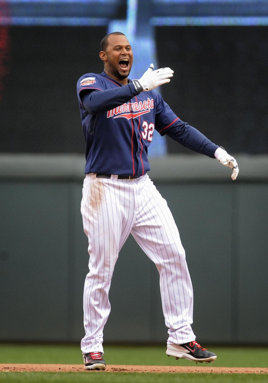 Minnesota Twins' Aaron Hicks reacts after singling off Boston Red Sox pitcher Andrew Miller to drive in the winning run during the tenth inning of a baseball game in Minneapolis, Thursday, May 15, 2014. Minnesota won 4-3.(AP Photo/Tom Olmscheid)