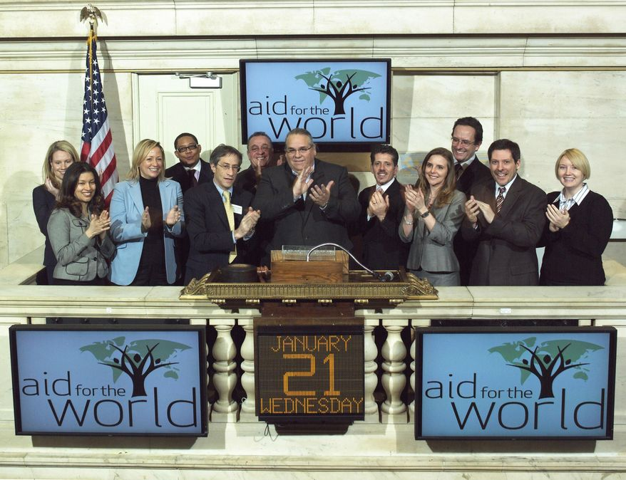** FILE ** In this Jan. 21, 2009, photo provided by the New York Stock Exchange, the Rev. Carl Keyes, founder of Aid for the World, rings the opening bell at the New York Stock Exchange. (AP Photo/NYSE)