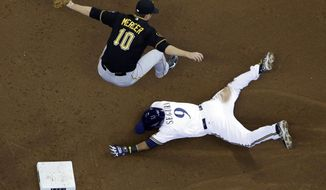 Pittsburgh Pirates shortstop Jordy Mercer can't handle a high throw as he leaps over Milwaukee Brewers' Jean Segura stealing second during the third inning of a baseball game Thursday, May 15, 2014, in Milwaukee. (AP Photo/Morry Gash)