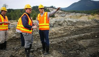 Washington Gov. Jay Inslee speaks with Snohomish County Council Chairman Dave Somers as Inslee checks on progress at the site of the Oso mudslide on Thursday, May 15, 2014 in Oso, Wash. Crews are progressing on unearthing State Highway 530. Some parts of the road will have to be rebuilt after it was washed away in the march mudslide that killed 41 people and left 2 missing. (AP Photo/Seattlepi.com, Josh Trujillo, Pool)