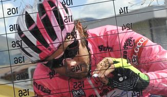 Overall leader Michael Matthews signs the starting list before the start of the start of the sixth stage of the Giro d'Italia, Tour of Italy cycling race, from Sassano to Montecassino, Italy, Thursday May 15, 2014.  (AP Photo/Gian Mattia D'Alberto)