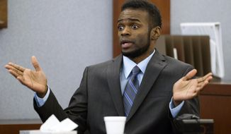 "Defendant Jason Omar Griffith speaks to the jury as he testifies in his own defense during his trial at the Regional Justice Center in Las Vegas Wednesday, May 14, 2014. Griffith is accused of murdering Luxor ""Fantasy"" dancer Deborah Flores Narvaez in December 2010. (AP Photo/The Las Vegas Sun, Steve Marcus) LAS VEGAS REVIEW-JOURNAL OUT"