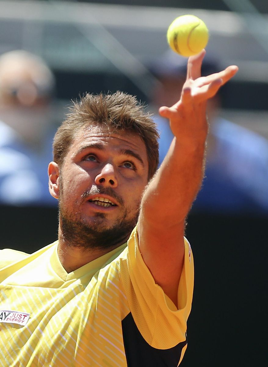 Switzerland's Stanislas Wawrinka serves the ball to Germany's Tommy Haas during their match at the Italian open tennis tournament in Rome, Thursday, May 15, 2014. (AP Photo/Gregorio Borgia)