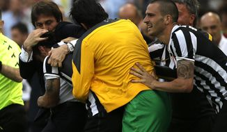 Juventus forward Pablo Daniel Osvaldo, second from right, celebrates after scoring with coach Antonio Conte during an Italian Serie A soccer match between Roma and Juventus at Rome's Olympic stadium, Sunday, May 11, 2014. (AP Photo/Alessandra Tarantino)