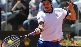Germany's Tommy Haas returns the ball to  Switzerland's Stanislas Wawrinka during their match at the Italian open tennis tournament in Rome, Thursday, May 15, 2014. (AP Photo/Gregorio Borgia)