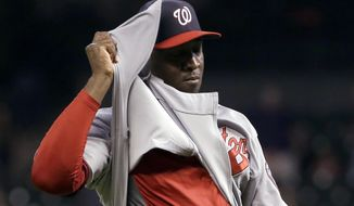 Washington Nationals relief pitcher Rafael Soriano untucks his jersey after the final out of the Nationals' baseball game against the Houston Astros on Tuesday, April 29, 2014, in Houston. The Nationals won 4-3. (AP Photo/David J. Phillip)