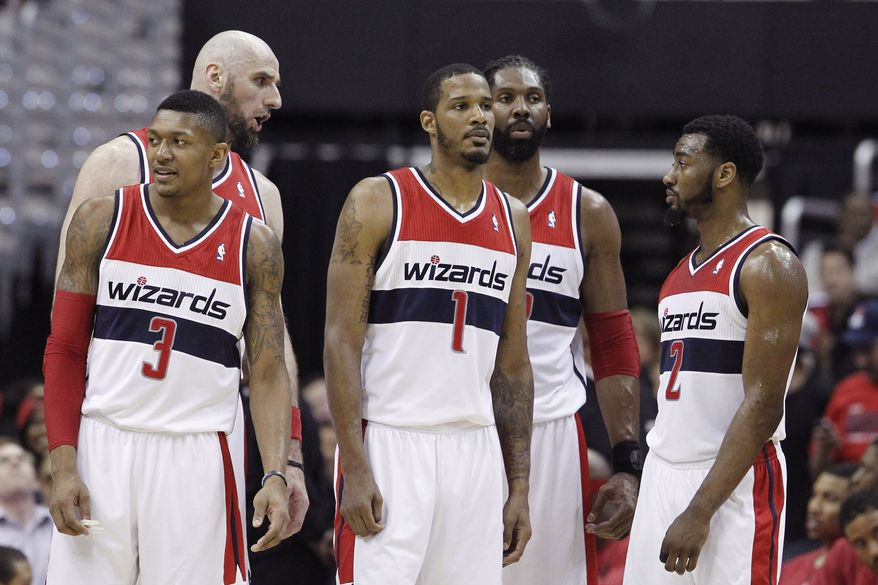 Washington Wizards (l-r) Bradley Beal, Marcin Gortat, Trevor Ariza, Nene, and John Wall stand on the court during a break in the action during the first half of Game 3 of an Eastern Conference semifinal NBA basketball playoff game against the Indiana Pacers in Washington, Friday, May 9, 2014. (AP Photo/Alex Brandon)