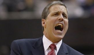 Washington Wizards coach Randy Wittman reacts to a call during the first half in Game 6 of an Eastern Conference semifinal NBA basketball playoff series against the Indiana Pacers in Washington, Thursday, May 15, 2014. (AP Photo/Alex Brandon)