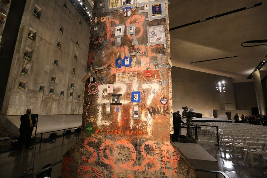 A steel beam from the World Trade Center stands at the center of Foundation Hall where the dedication ceremony will take place at the National September 11 Memorial Museum on Thursday, May 15, 2014 in New York.  President Barack Obama and Sept. 11 survivors, rescuers and victims' relatives are expected to mark the opening of the 9/11 museum, where the story of the terrorist attacks is told on a scale as big as the twin towers' columns and as intimate as victims' last voicemails.   (AP Photo/The Star-Ledger, John Munson, Pool)
