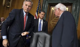 Veterans Affairs Secretary Eric Shinseki, center, meets with Senate Veterans Affairs Committee Chairman Sen. Bernie Sanders, I-Vt., right, and the committee's ranking member Sen. Richard Burr, R-N.C., on Capitol Hill in Washington, Thursday, May 15, 2014, following his testimony at the committee's hearing to examine the state of Veterans Affairs health care. (AP Photo/Cliff Owen)