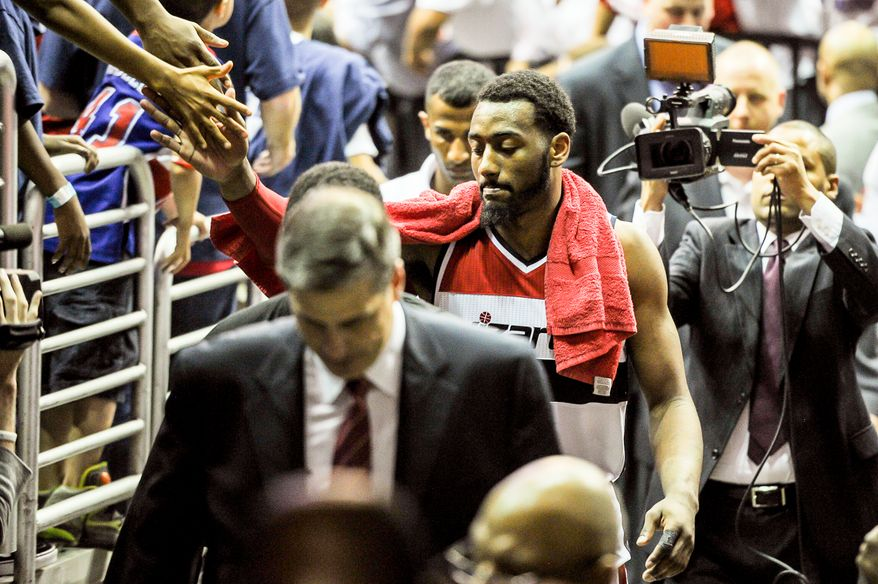 Washington Wizards guard John Wall (2) leaves the court after the Washington Wizards lose to the Indiana Pacers, 93-80, during game 6 of the 2nd round of the NBA Playoffs at the Verizon Center, Washington, D.C., Thursday, May 15, 2014. (Andrew Harnik/The Washington Times)