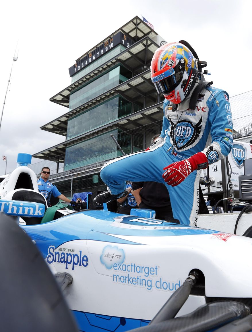 Driver James Hinchcliffe, of Canada, climbs into his car during practice for Indianapolis 500 IndyCar auto race at the Indianapolis Motor Speedway in Indianapolis, Friday, May 16, 2014. (AP Photo/AJ Mast)