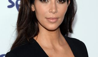 Kim Kardashian arrives at the NBCUniversal Cable Entertainment 2014 Upfront at the Javits Center on Thursday, May 15, 2014, in New York. (Photo by Evan Agostini/Invision/AP)