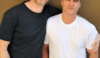 "In this Friday, May 9, 2014 photo, screenwriter-director, James Gray, left, and actor Joaquin Phoenix from the film, ""The Immigrant,"" pose for a portrait during an interview in Los Angeles.  The movie opens in the U.S. with a limited release on May 16, 2014. (Photo by Katy Winn/Invision/AP)"