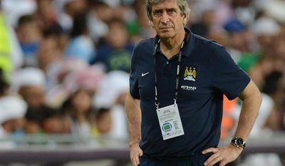 Manchester City's manager Manuel Pellegrini watches the friendly match against UAE's Al-Ain club in Al Ain, United Arab Emirates, Thursday, May 15, 2014. (AP Photo)